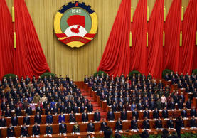 Xi Jinping, China's president, ninth from right in the second row, and  Li Keqiang, eighth from right in the second row, attend the opening of the Chinese People's Political Consultative Conference (CPPCC) at the Great Hall of the People in Beijing, China, on Tuesday, March 3, 2015. China's annual meeting of the National People's Congress, which begins March 5 in Beijing, is expected to set government policies for the year on issues ranging from economic growth to military spending and pollution.