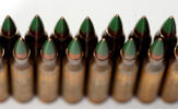"Green tip, M855 5.56mm ammunition is photographed Monday, March 2, 2015, in Fort Washington, Md. The Bureau of Alcohol, Tobacco, Firearms and Explosives is proposing the ban of ""M855 green tip"" or ""SS109"" rounds with certain types of metal cores."