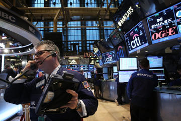Floor traders at the New York Stock Exchange, MArch 6, 2015.