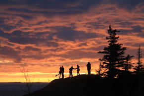 Three couples enjoy the spring equinox sunset over Turnagain Arm from Beluga Point on Saturday, March 21, 2015, in Anchorage, Alaska. The high temperature Saturday reached a high of 42 degrees, 7 degrees above the normal high, according to the National Weather Service.