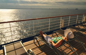 Woman relaxing on cruise ship deck.