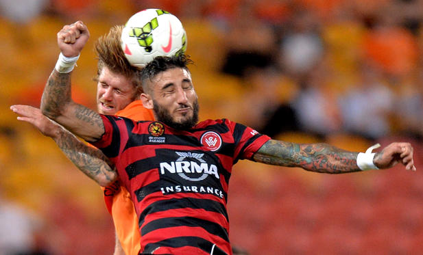 Kerem Bulut of the Western Sydney Wanderers and Luke Brattan of the Roar challenge for the ball during the round 21 A-League match between Brisbane Roar and the Western Sydney Wanderers at Suncorp Stadium on Wednesday in Brisbane, Australia.
