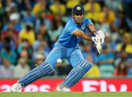 India's MS Dhoni plays a shot while batting against Australia during their Cricket World Cup semifinal in Sydney, Australia, Thursday, March 26, 2015.