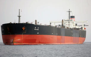 Japanese oil tanker Takayama sails outside Yemen's southern port of Aden April 22, 2008. The ship was fired on in the Gulf of Aden, off Yemen on Monday, owner Nippon Yusen KK said, with Japanese media reporting the ship was hit by a rocket in the pirate-infested region. None of the 23 crew on board the Takayama were injured and the tanker was capable of continuing its voyage, Nippon Yusen spokesman Satoshi Yokoyama said. REUTERS/Khaled Abdullah (YEMEN)