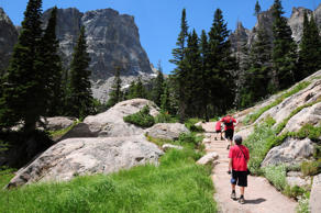 Kids hiking on the trail leading to Emerald Lake in the Bear Lake region of Rocky Mountain National Park.