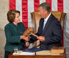 House Speaker John Boehner of Ohio, right, is handed the gavel from House Minority Leader Nancy Pelosi, D-Calif, left, after being re-elected for a third term to lead the 114th Congress, as Republicans assume full control for the first time in eight years, at the Capitol in Washington, Tuesday, Jan. 6, 2015.