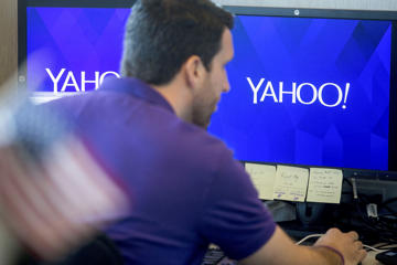 An employee works at the Yahoo! Inc. Customer Care Center of Excellence in Amherst, New York, U.S., on Friday, Sept. 26, 2014. Yahoo Inc., a $40 billion Web portal, is expected to release third quarter earnings on Oct. 21.