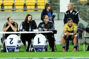 TJ Perenara of the Hurricanes looks on from the sin-bin after receiving a yellow card.