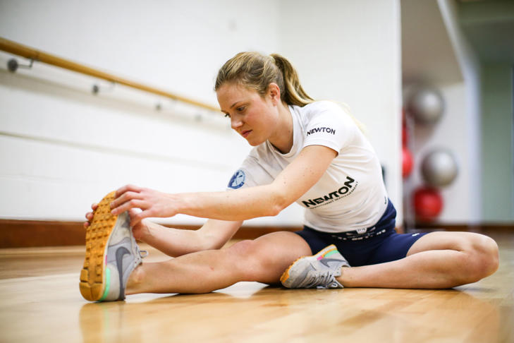 Emily Reynolds of the Oxford Women's crew stretches before a weights session at the Virgin Active gym.
