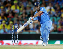 India's MS Dhoni hits the ball for six runs while batting against Australia during their Cricket World Cup semifinal in Sydney, Australia, Thursday, March 26, 2015.