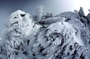 Rime ice covers rocks on the summit of Mount Washington in New Hampshire on Tuesday, March 10, 2015. Rime ice occurs when freezing fog hits stationary objects in frigid conditions.