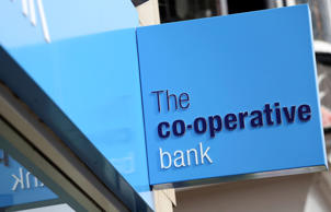 Co-op Bank cuts losses as it axes staff and branches