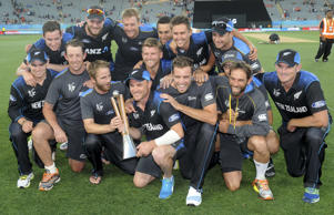 The New Zealand team pose with the Chappell Hadlee after defeating Australia in their Cricket World Cup match in Auckland, New Zealand.