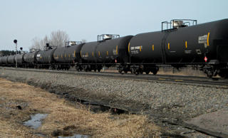 In this April 15, 2014 file photo, an oil-tank train with crude oil from the Bakken shale fields of North Dakota travels near Staples, Minn. Mike Cronin/AP