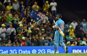 Virat Kohli walks off after being dismissed during the 2015 Cricket World Cup semi-final match between Australia and India in Sydney