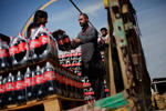 Workers load pallets of Coca-Cola Co. beverage at the Habib Gulzar Non-Alcoholic Beverage Ltd. bottling facility in Kabul, Afghanistan.
