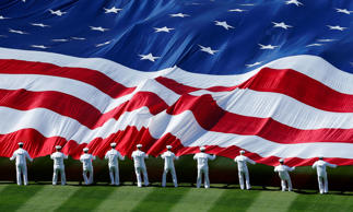 An American flag is unfurled before a baseball game in San Diego, Califdornia, April 9, 2013.