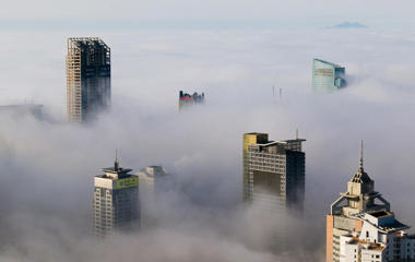 Buildings peek through fog in Qingdao, China, on March 27.