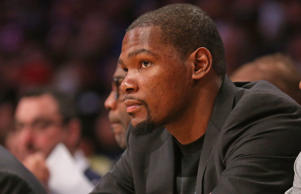 Injured player Kevin Durant of the Oklahoma City Thunder looks on from the bench during the game against the Los Angeles Lakers at Staples Center on March 1, 2015 in Los Angeles, California.
