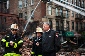 New York City Mayor Bill De Blasio at the scene of a building collapse in New York's East Village on March 27, 2015.
