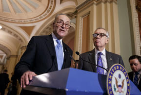 Democratic leaders Sen. Chuck Schumer, D-N.Y., left, and Senate Minority Leader Harry Reid, D-Nev., meet with reporters at the Capitol in Washington, March 3, 2015.