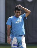 India's captain M S Dhoni rubs his head after batting practice for training at the Cricket World Cup in Sydney, Australia, Wednesday, March 25, 2015.