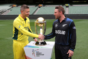 Australia's captain Michael Clarke, left, and New Zealand's captain Brendon McCullum shake hands as they pose for a photo with the Cricket World Cup trophy at the MCG in Melbourne, Australia, Saturday, March 28, 2015. New Zealand will tackle Australia  in the Cricket World Cup final Sunday.