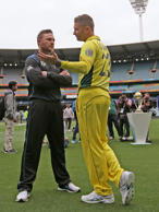 New Zealand's captain Brendon McCullum, center left, talks with Australia's captain Michael Clarke following a photo shoot with the Cricket World Cup trophy at the Melbourne Cricket Ground in Melbourne, Australia, Saturday, March 28, 2015. New Zealand will play Australia in the final Sunday.