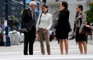 Second from the left, Ellen Pao, former junior partner at Kleiner Perkins Caufield & Byers arrives at state court with her lawyers in San Francisco, Calif., March 27, 2015.