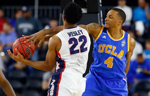 Byron Wesley of the Gonzaga Bulldogs takes a shot against Norman Powell of the UCLA Bruins during a South Regional Semifinal game of the 2015 NCAA Men's Basketball Tournament at NRG Stadium on March 27, 2015 in Houston, Texas.