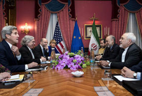 From left, Secretary of State John Kerry U.S., Secretary of Energy Ernest Moniz sits across from Head of the Iranian Atomic Energy Organisation Ali Akbar Salehi and Iranian Foreign Minister Javad Zarif  wait with others ahead of a meeting at the Beau Rivage Palace Hotel in Lausanne on March 26, 2015.