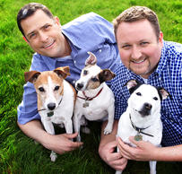 Rob Ingersoll, left, and Curt Freed pose with their dogs in Kennewick, Wash., on Tuesday, April 16, 2013. The American Civil Liberties Union in Washington state filed a lawsuit Thursday on behalf of the Kennewick gay couple which was Kdenied service at a flower shop for their upcoming wedding.