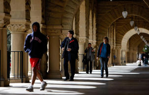 Students walk through an open corridor on the Stanford University campus in Palo Alto, California.