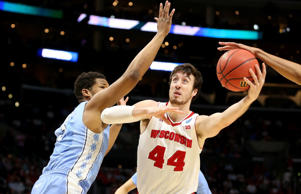 Frank Kaminsky of the Wisconsin Badgers with the ball against Kennedy Meeks of the North Carolina Tar Heels in the first half during the West Regional Semifinal of the 2015 NCAA Men's Basketball Tournament at Staples Center on March 26, 2015 in Los Angeles.