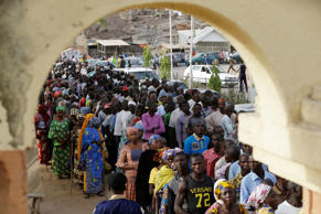 People displaced following attacks by Islamist militants lineup for accreditation before casting their votes, in Yola, Nigeria, Saturday March 28, 2015. Nigerians went to the polls Saturday in presidential elections which analysts say will be the most tightly contested in the history of Africa's richest nation and its largest democracy.