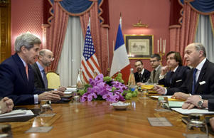 US Secretary of State John Kerry (L) and French Foreign Minister Laurent Fabius (R) talk before a meeting at the Beau Rivage Palace Hotel March 28, 2015 in Lausanne.