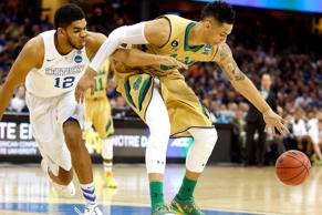 Karl-Anthony Towns #12 of the Kentucky Wildcats and Zach Auguste #30 of the Notre Dame Fighting Irish go for a loose ball in the first half during the Midwest Regional Final of the 2015 NCAA Men's Basketball tournament at Quicken Loans Arena on March 28, 2015 in Cleveland, Ohio.