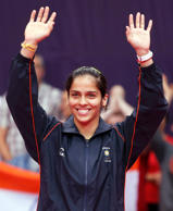 Bronze medallist India's Saina Nehwal waves to the crowd at the women's singles badminton victory ceremony at the London 2012 Olympic Games at the Wembley Arena August 4, 2012.