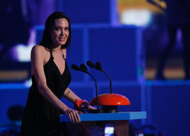 Actress Angelina Jolie accepts the Best Villain Award at the 2015 Kids' Choice Awards in Los Angeles, California March 28, 2015.