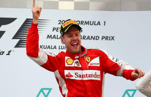 Sebastian Vettel of Ferrari celebrates his win in Malaysia