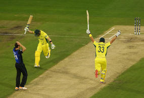 Steve Smith and Shane Watson of Australia celebrate after defeating New Zealand.
