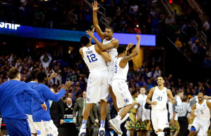 Aaron Harrison #2 of the Kentucky Wildcats celebrates with teammates after defeating the Notre Dame Fighting Irish during the Midwest Regional Final of the 2015 NCAA Men's Basketball tournament at Quicken Loans Arena on March 28, 2015 in Cleveland, Ohio.