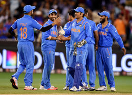 India's MS Dhoni, centre, celebrates with his players after their 109 run win over Bangladesh in their Cricket World Cup quarterfinal match in Melbourne, Australia, Thursday, March 19, 2015.