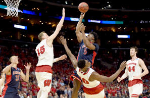 Stanley Johnson #5 of the Arizona Wildcats is called for a charge on Nigel Hayes #10 of the Wisconsin Badgers in the first half during the West Regional Final of the 2015 NCAA Men's Basketball Tournament at Staples Center on March 28, 2015 in Los Angeles, California.