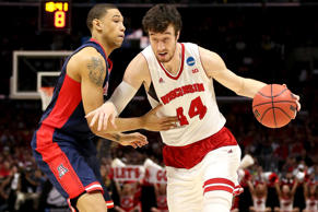 Frank Kaminsky #44 of the Wisconsin Badgers drives on Brandon Ashley #21 of the Arizona Wildcats in the first half during the West Regional Final of the 2015 NCAA Men's Basketball Tournament on March 28 in Los Angeles.