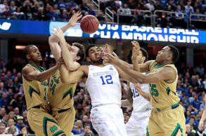 Notre Dame's V.J. Beachem (3), Pat Connaughton (24), and Bonzie Colson (35) battle Kentucky's Karl-Anthony Towns (12) for a first-half rebound in the NCAA Tournament's Elite 8 on Saturday, March 28, 2015, at Quicken Loans Arena in Cleveland.
