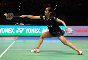 India's Saina Nehwal plays a shot during the Women's Singles final, against  Spain's Carolina Marin at the All England Badminton Championships in Birmingham, England, Sunday, March 8, 2015.