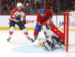 Florida Panthers goalie Roberto Luongo (1) makes a save against Montreal Canadiens right wing Brendan Gallagher (11) as defenseman Aaron Ekblad (5) defends during the third period at Bell Centre.