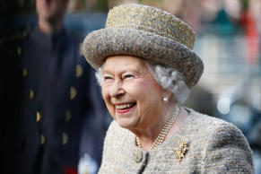 Queen Elizabeth II Queen Elizabeth II smiles as she arrives for the opening of the Flanders' Fields Memorial Garden at Wellington Barracks in London. The Flanders Fields Memorial Garden has been created with soil taken from the 70 battlefields and Commonwealth War Grave Cemeteries in Flanders.
