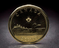A Canadian loonie is pictured in North Vancouver, B.C. Monday, Jan. 26, 2015.